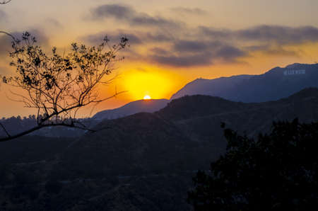 Los Angeles, California - June 9th, 2013 : This is the view at sunset of the Hollywood sign in the distance from the north side of Griffith Observatory located on Mount Hollywood