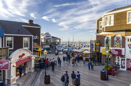 San Francisco, California - June 12, 2013 : Shops and restaurants in Pier 39, with a view of the San Francisco Bay