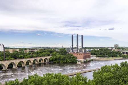 Minneapolis, Minnesota - June 17, 2013   The Stone Arch Bridge is a former railroad bridge crossing the Mississippi River at Saint Anthony Falls in downtown Minneapolis, Minnesota  The structure is now used as a pedestrian and bicycle bridge  It is an His