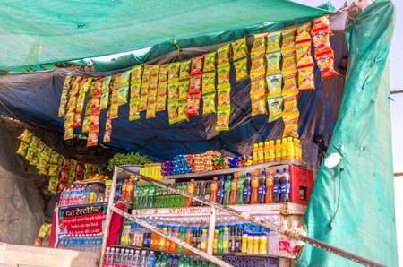 eatables: Mount Abu, Rajasthan - Jan 02, 2014   A shop sellings snacks and soft drinks on the way up to the Dattatreya temple at the Guru Shikhar peak in Mount Abu in Rajasthan, India