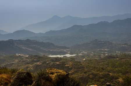 The Arbuda mountains of the Aravalli Range as viewed from Guru Shikhar, highest point in Mount Abu, Rajasthan, India
