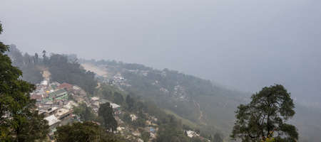 west bengal: Darjeeling, West Bengal - January 8, 2014   The beautiful scenic town of Darjeeling on a foggy winter evening  Darjeeling is a town in West Bengal state of India  A popular tourist destination, it is located in the Mahabharat Range or Lesser Himalaya at a