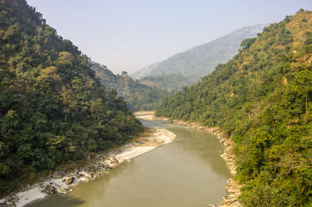joins: The Teesta river starts from the Himalayan mountains in Sikkim crosses west Bengal and joins the Brahmaputra river  Stock Photo