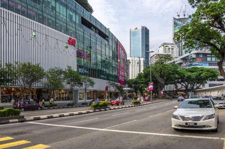 Kuala Lumpur, Malaysia - June 15,  2014  Shopping area on Jalan Ampang road alongside Petronas twin towers in Kuala Lumpur in Malaysia