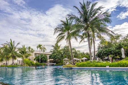 Hua Hin, Thailand - July 1st, 2014   A lavish pool with coconut trees in Sheraton Hua Hin Resort   Spa in Hua Hin, Thailand