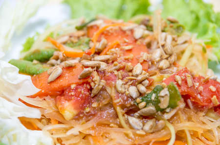 Closeup of Somtam, the famous Thai papaya salad photo
