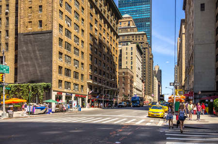 boroughs: New York, NY - August 9th, 2014 : The  upscale 7th Ave of Manhattan. It is the most densely populated of the five boroughs of New York City, USA.