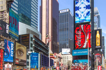 New York, NY - August 9th, 2014 : The brightly adorned billboards & advertisements in Times Square. It is a major commercial intersection and a neighborhood in Midtown Manhattan, New York City, USA.