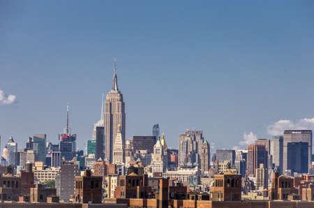 manhatan: New York, NY - August 9th, 2014 : The Skyline of Manhatan as seen from Brooklyn bridge in Nyew York, USA
