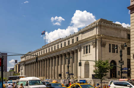 New York, NY - August 9th, 2014 : The majestic Post Office building at the west 33rd street and 8th Avenue in Lower Manhattan in New York, USA