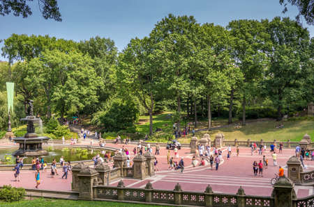 bethesda: New York, NY - August 10, 2014 : Tourists at the Bethesda Fountain in Central Park. Central Park is National Historic Landmark, an urban park in the central New York City borough of Manhattan in New York, USA.