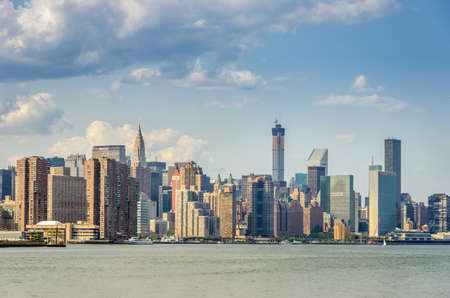 A view of Manhattan skyline with skycrapers over East river in Manhattan, New York, USA