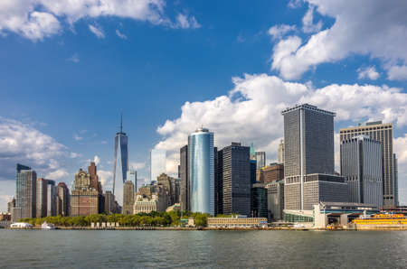 A view of Manhattan skyline with skycrapers, tourist boats and piers in Manhattan, New York, USA Stock Photo