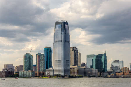 A view of Union city skyline with skycrapers and clouds over Hudson river in New York, USA
