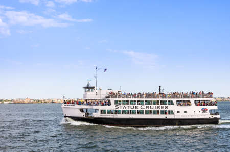 New York, NY - September 10, 2014 : The Statue Cruises sightseeing tours sailing on the Hudson river in New York, USA Editorial
