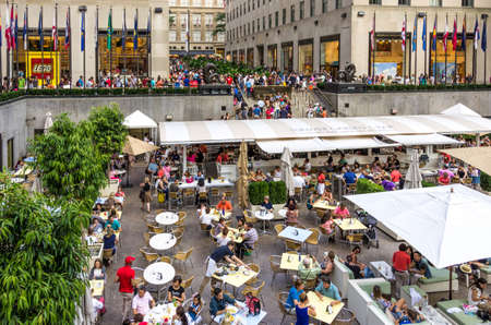 New York, NY - September 10, 2014 : A busy cafe with tourists in  Rockfeller plaza next to Top of The Rock in Manhattan, New York, USA