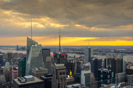 View of Manhattan skyline at sunset from Top of the Rock in Manhattan, New York in USA.