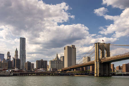 The Brooklyn bridge with a view of Manhattan in the background in New York, USA