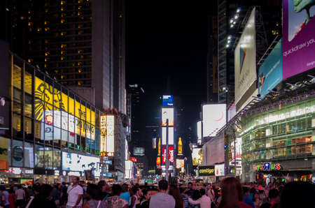 New York, NY - August 10, 2014 : Famous Times Square at night Brightly lit up billboards and packed with tourists from all over the world in Midtown Manhattan broadway , New York, USA.