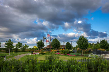 View of the beautiful Pugatory Creek Park pavillion against a backdrop of clouds in Eden Prairie, Minnesota, USA.