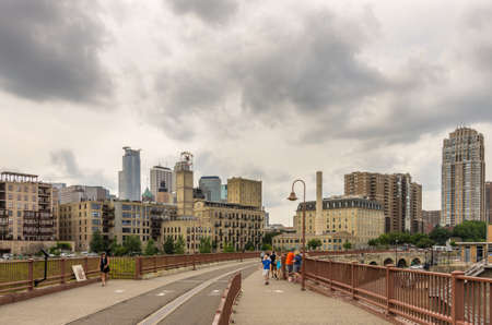 minneapolis, Minnesota - August 21, 2014: The Stone Arch bridge across the Mississippi river at the famous Mill Ruins Park in Minneapolis, MN, USA