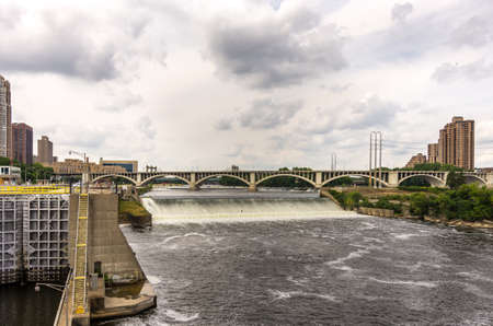 minneapolis, Minnesota - August 21, 2014: The old historical St. Anthony Falls upper lock and dam at the Mississippi river alongside the Mill City Ruins in Minneapolis, MN, USA