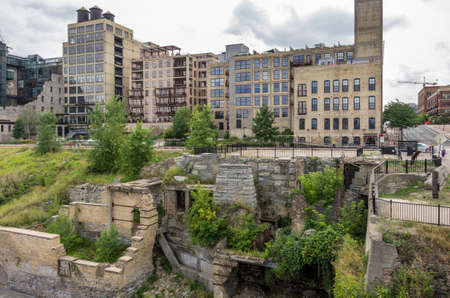 Minneapolis, Minnesota - August 21, 2014: The Mill Ruins Park is located on the historic Mississippi Riverfront in Minneapolis, MN, USA. The park symbolizes return of the city to its roots. Editorial