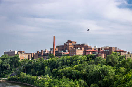 Minneapolis, Minnesota - August 20, 2014: A view of a helicopter ambulance landing at the University of Minnesota Medical Center, Fairview. It is in Minneapolis, Minnesota.