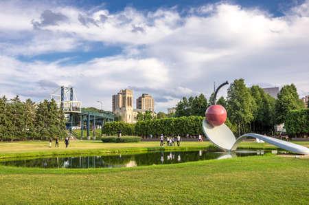 Minneapolis, Minnesota - August 20, 2014:  The spoonbridge and cherry sculpture by Claes Oldenburg, Coosje van Bruggen at the Minneapolis Sculpture Garden in Minneapolis , Minnesota