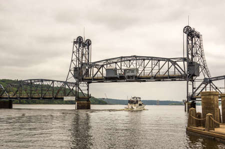 river county: Stilwater, Minnesota - Aug 23,  2014 : Stillwater is a city in Washington County, Minnesota, directly across the St. Croix river from the state of Wisconsin. The lift bridge is in the background Editorial