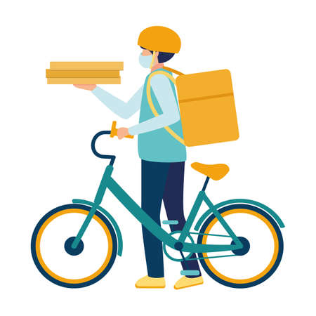 A medical masked courier delivers food on a bicycle during the Covid19 coronavirus virus epidemic. Deliveryman with a parcel box on the back and pizza boxes in hand. Boy with food delivery service.
