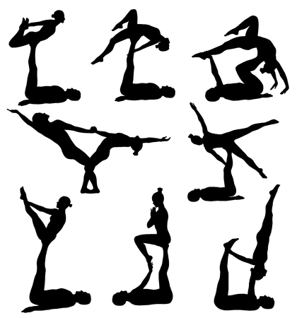 Silhouettes of man and woman doing acrobatic yoga