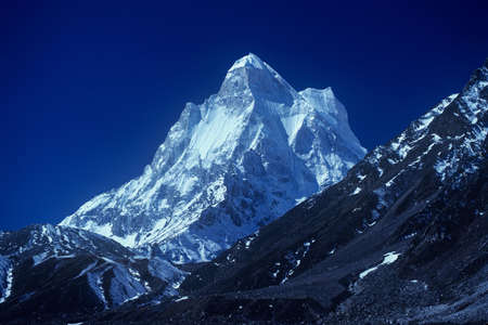 shivling: Shiv Ling Peak, Garhwal Himalayas, Uttarakhand, India: 13 ecember, 2005: Snow Covered Shivling at Tapovan in Western Garhwal Himalayas in Uttarakhand, India.Shivling is a mountain at Tapovan in the Gangotri Group of Peaks in the western Garhwal Himalayas,