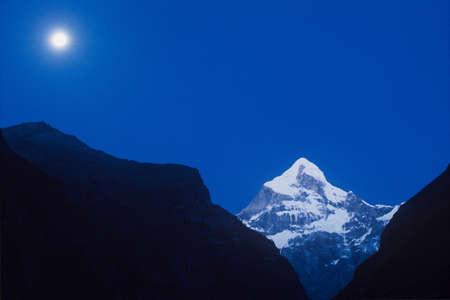 Neelkanth Peak, Uttarakhand, India-13 December, 2006: Neelkanth Peak on full moon night at Uttarakhand, India.Neelkanth is a mojor peak of the Garhwal division of the Himalayas, in Uttarakhand, India. substantially lower than the highest peaks of the regi Stock Photo