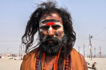 sadhu: Allahabad, Uttar Pradesh, India- 15 January, 2013: An Aghori Sadhu with long hairs, ash and tilak on face wearing human bones and  rudraksha bead at Mahakumbh mela, Allahabad, Uttar Pradesh, India.The Aghori are known to engage in post-mortem rituals.  Th