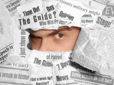 Sceptic look through the newspapers Stock Photo - 10850102