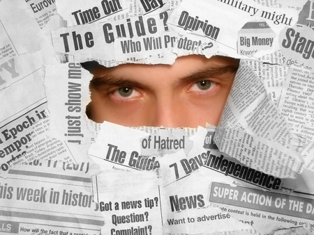 Man looking tiredly through the newspapers collage Stock Photo - 10850104