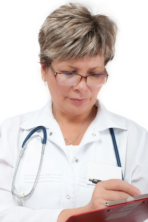 desease: Mature woman doctor writing prescription