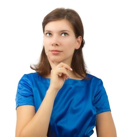 Young woman in blue dress wondering Foto de archivo