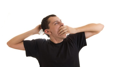 Young man yawning and stretching photo