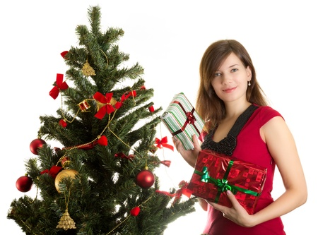Beautiful woman with presents near Christmas tree Stock Photo - 11210258