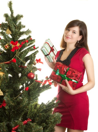 Beautiful woman with presents near Christmas tree Stock Photo - 11210261