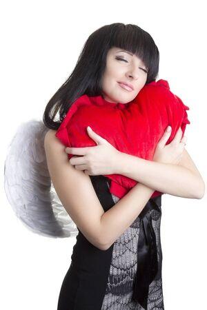 Mujer hermoso ángel abrazando corazón rojo Foto de archivo - 11323794