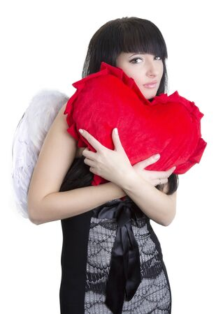 Beautiful angel woman embracing red heart photo