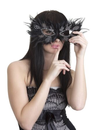 Beautiful woman with mask and finger near lips photo