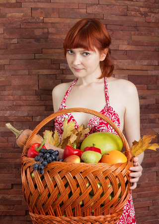 willow fruit basket: Redhead girl with a basket of autumn fruits and leaves