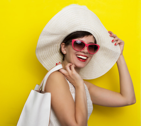 woman beach dress: Happy woman in hat and sun glasses