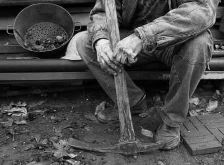 having a break: Miner having a break Stock Photo