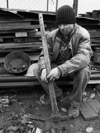 having a break: Miner having a break from hard work Stock Photo