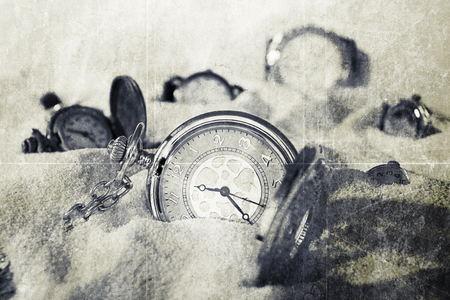 limitation: Watches lying on the sand of the desert